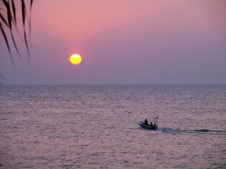 Sunset in the Indian ocean round the island Sri Lanka photo