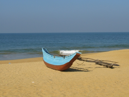 a traditional fishingt boat on the beach in Sri Lanka Stock Photo - 17698932
