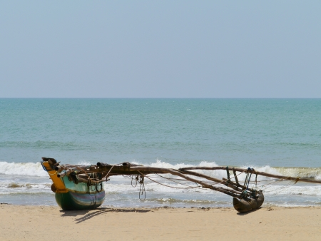 A traditional fishing boat on the beach in Sri Lanka Stock Photo - 17826321