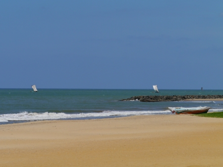 Sailing traditional fishing boats and a modern boat on the beach in Sri Lanka Stock Photo - 17819590