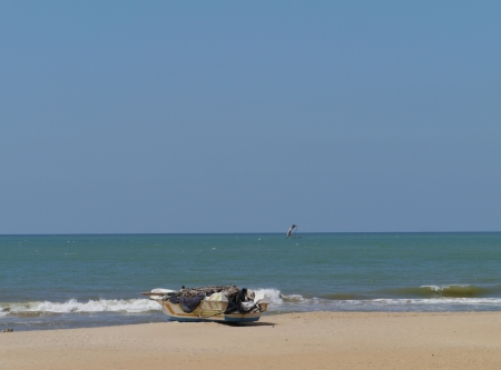 A motor fishing boat on the beach in Sri Lanka photo