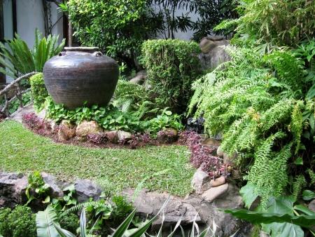 A tropical garden with a ceramic vase Stock Photo - 18005298