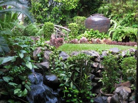 A tropical garden with a ceramic vase Stock Photo - 18005295