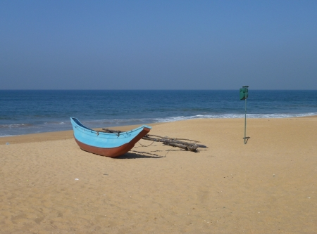 A traditional fishing boat on the beach in Sri Lanka Stock Photo - 18062078