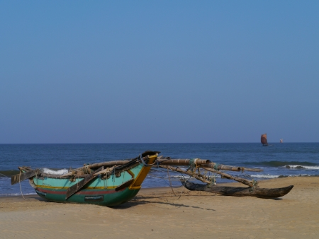 A traditional fishing boat on the beach in Sri Lanka Stock Photo - 18096447