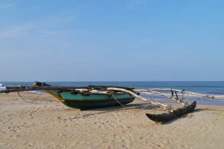 A traditional fishing boat on the beach in Sri Lanka Stock Photo - 18096450