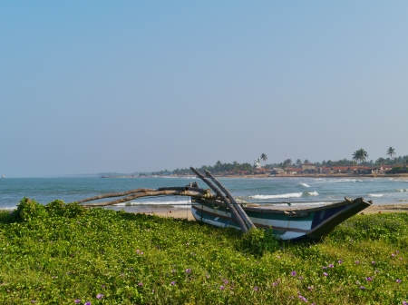 A traditional fishing boat on the beach in Sri Lanka Stock Photo - 18096478