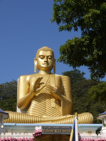 A huge Buddha at the golden temple in Dambula in Sri Lanka Stock Photo - 18232159