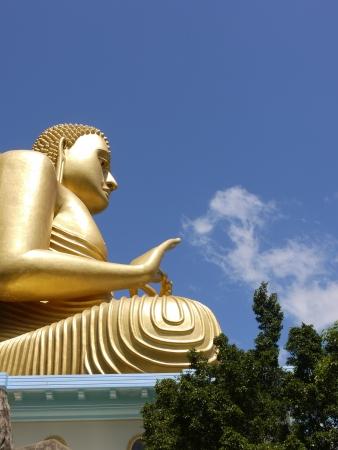A huge Buddha at the golden temple in Dambula in Sri Lanka Stock Photo - 18232158