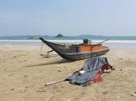 A traditional fishing boat on the beach in Sri Lanka Stock Photo - 18199702