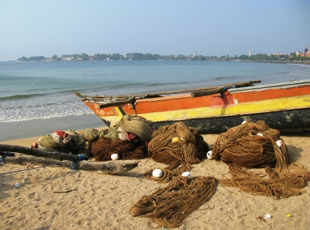 A traditional fishing boat on the beach in Sri Lanka photo