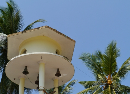 The bell tower and a palm tree at the Wewurukannala Vihara temple in Sri Lanka Stock Photo - 18229855
