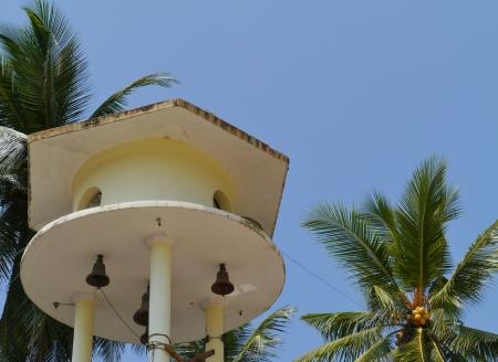 wewurukannala: The bell tower and a palm tree at the Wewurukannala Vihara temple in Sri Lanka Stock Photo