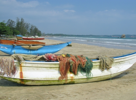 Traditional fishing boats on the beach in Sri Lanka photo