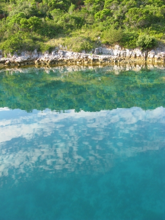 The colors of a rocky coast in a bay in the Adriatic sea of Croatia Stock Photo - 18272264