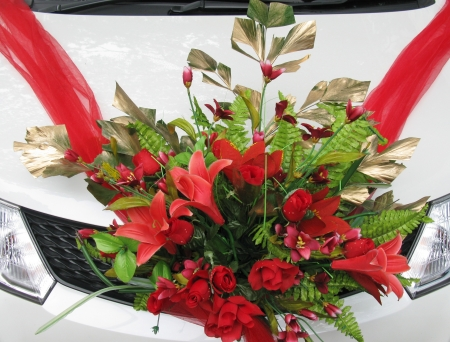 Red flower arrangement for a wedding on a car Stock Photo - 18615475