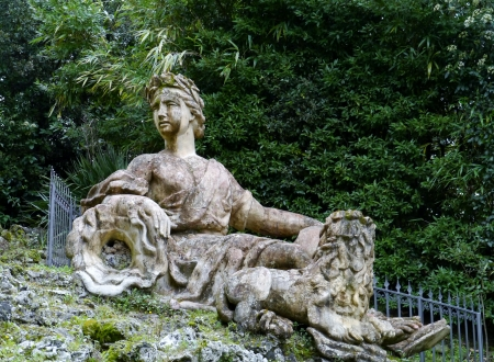 One of the sculptures in the garden of the villa Garzoni in Collodi in Italy photo