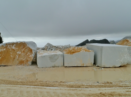 famous industries: Blocks of marble in an open quarry of white marble in Carrara in Tuscany in Italy