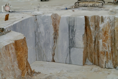 An open quarry of white marble in Carrara in Tuscany in Italy photo