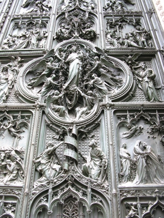 nascent: A detail of the bronze door of the gothic cathedral of Milan in Italy Stock Photo