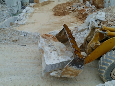 A block white marble on a shovel photo