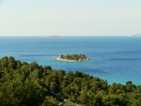 The island Tuzbina near the Kosirina bay of the island Murter in Croatia photo