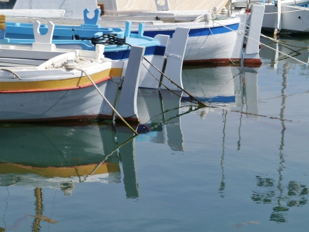 The small harbour of the village Betina on the island Murter in Croatia with ancient wooden fishing boats Stock Photo - 19220637