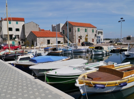 betina: The small harbour of the village Betina on the island Murter in Croatia with ancient wooden fishing boats Stock Photo