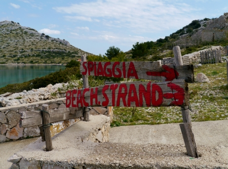 arrows tot the beach on the island Levrnaka in Croatia photo