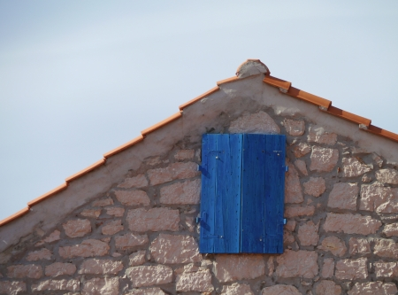 An old house with blue wooden shutters in Betina on the island Murter in Croatia Stock Photo - 19220651