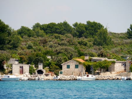 Fisherman houses at the bay of Prtljug on the island Ugljug in the Adriatic sea of Croatia