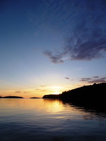 Sunset in the bay of Pomena of the island Mljet in the Adriatic sea of Croatia photo