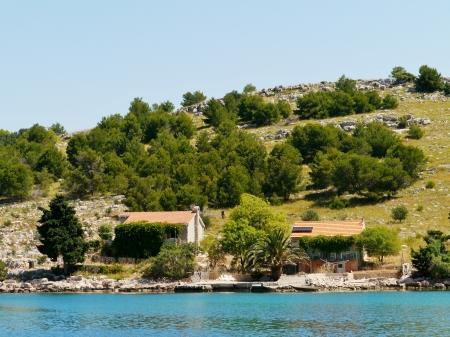 kornat: Summer houses in the Statival bay of the island Kornat in Croatia Stock Photo