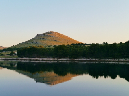 kornat: The early morning sun on the isle Kornat in the Statival bay of the Kornati national park in the Adriatic sea of Croatia