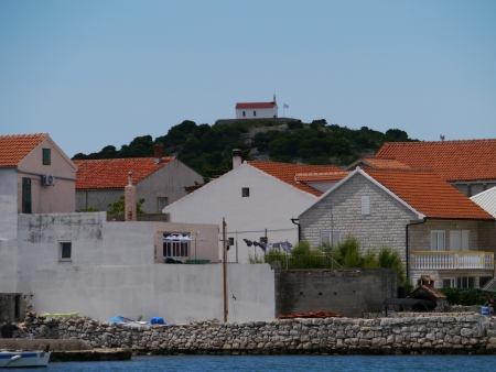 Houses in the village Betina at the island Murter in Croatia photo