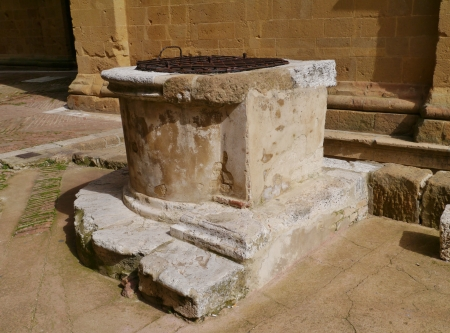 One of the historic wells in the city Pienza in Tuscany in Italy   photo