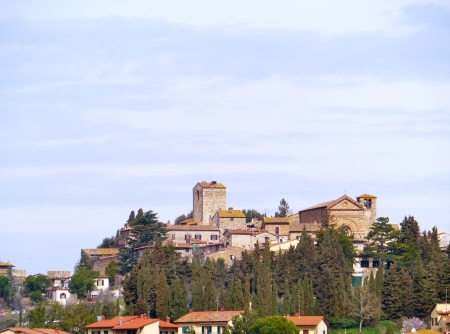 The city Orvieto rising above tuff cliffs and defensive walls in Umbria in Italy photo