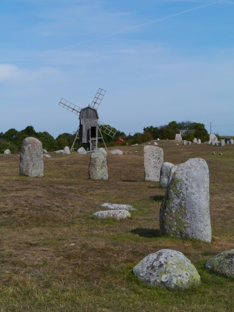 oland: The burial ground of the village Gettlinge with  a historic wooden wind mill on the island Oeland in Sweden