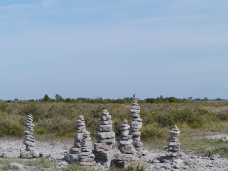 man made: Cairns,  man made piles or stacks of stone on the island Oeland in Sweden Stock Photo