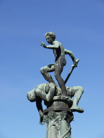 A fountain with a sculpture David and Goliath of bronze in the coastal city Kalmar in Sweden