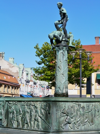 david and goliath: A fountain with a sculpture David and Goliath of bronze in the coastal city Kalmar in Sweden