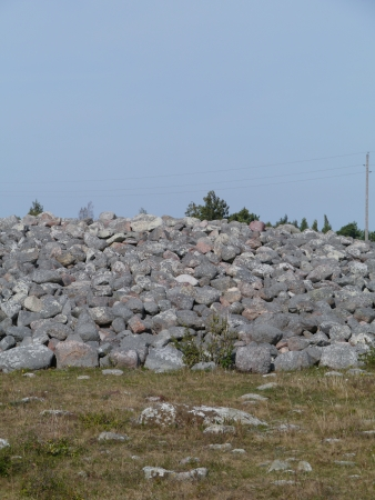 Boulders on a burial mound on the island Oeland in Sweden photo