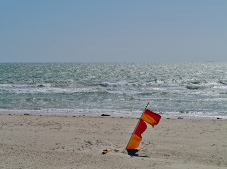 The flags on the beach in Adelaide in Australia means dangerous sea forbidden to swim Stock Photo - 24221565