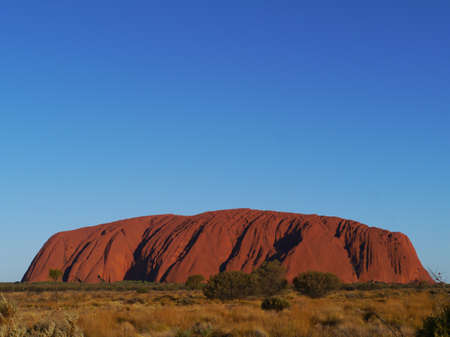 the famous: Ayers rock or Uluru a sandstone formation in the Northern territory in Australia Editorial