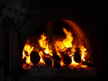 A forge is a hearth used for heating metals in the working place of a black smith photo