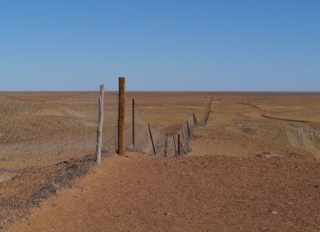 stock vista: The dog fence in the Southern states of Australia is the longest fence in the world Stock Photo