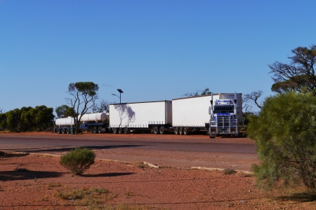 A long truck train on Stuart highway in the desert of the Northern Territory and South Australia photo