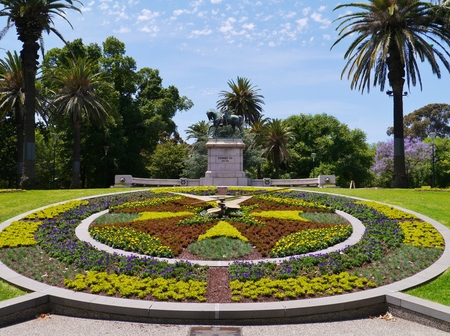 The floral clock and the statue of King Edward VII in the Queen Victoria gardens in Melbourne in Australia photo