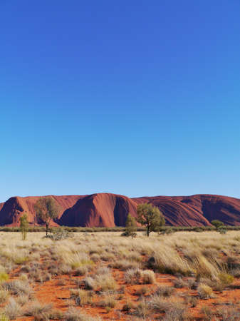 Ayers rock or Uluru a sandstone formation in the Northern territory in Australia photo