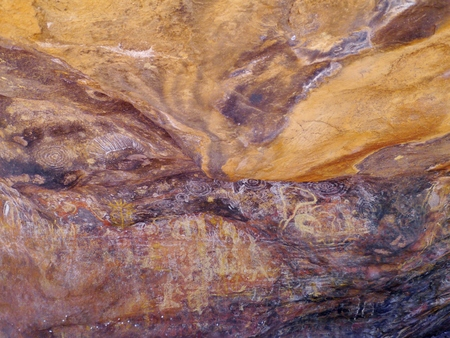 Aboriginal paintings at Ayers rock in Australia photo
